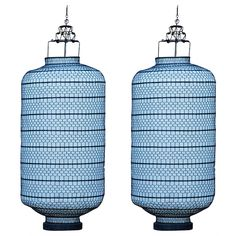 amazing pair of large wire mesh and linen lanterns from the james bond movie set: skyfall - 20thc - via blend interiors, ref. : U12112681841401 - height: 41 in. (104 cm)   diameter: 18 in. (46 cm) -  3,000 usd