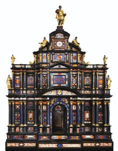 The Borghese-Windsor Cabinet, c. 1620. This late mannerist masterpiece looks like a miniature building, or perhaps a sumptuous object on a grand scale (its dimensions are 178 cm high, x 126 cm wide x 54 cm deep). Composed of three storeys, its facade is completely covered with pietre dure, and divided by two orders of columns with lapis lazuli veneers. The figure of a Roman Emperor is set on top of the cabinet. The arms in the central pediment are those of Pope Paul V (Borghese). -Sotheby's- European Furniture, Art Furniture, Antique Furniture, Roi George, King George Iv, Antique Curio Cabinet, Ancient Egyptian Tombs, Bird Cages, Architecture