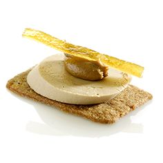 Simple appetizer idea!  Ginger thin with foie gras, spread of caramelised biscuit and lemon zest
