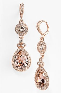 In love with these sparkly crystal and rose gold teardrop earrings.