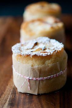mini french apple cakes wrapped with a strip of natural parchment and baker's twine