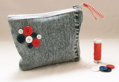 Make Up Bag / Cosmetic / Pencil Case / Denim Zipper Pouch /Jeans / Buttons / Upcycled / Handmade. $15.00, via Etsy.