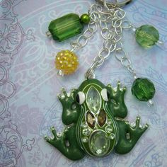 """Green Frog Key Chain Purse Chain Bag Chain Gift for Her Nature Delightful key chain for frog lovers! This chain can be used for keys, a bag chain, a purse chain or even to hang in your car. The chain has beads and a delightful rhinestone frog. The frog is good sized, measuring 2"""" long and 2 1/2"""" wide. The chains hang about 4 1/2"""" . Definitely a conversation piece! Artist designed and created."""