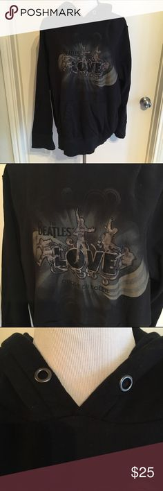 Beatles Love Black Screen Print Hoodie Only worn twice! This was purchased at the Cirque du Soleil show Beatles Love and is simply too large for me, so it has never gotten much wear. Features a beautiful screen print on the front of the Beatles and the Love logo. Long sleeve, hood is double lined with a ribbed fabric. I don't remember if the hood came with drawstrings, I don't believe it did, but there aren't any today. Super cozy and cool. Cirque du Soleil LOVE Tops Sweatshirts & Hoodies