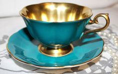 Satin Finish Royal Albert All Turquoise/Teal and All Gold Satin Teacup and Saucer Made in England c1950s. VERY RARE - EXQUISITE TEACUP & SAUCER BY. The teacup is in The Avon Shape with Flared Mouth. ROYAL ALBERT. | eBay!