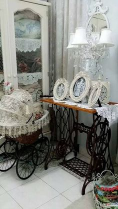 Wonderful display. Just love it. Always love the singer tables, and the carriage is great.