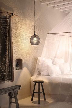 Unique Hotel Design Concepts in Greek : Shiny Pendant Lamp Greek Island Retreat Wood Stool Canopy Bed