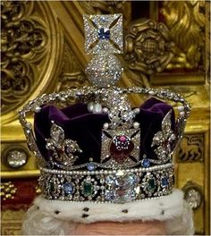 The Imperial State Crown was made in 1838 for the Coronation of Queen Victoria, and then altered for the Coronation of George VI in 1937 and Elizabeth II in 1953.   The Black Prince's Ruby is set into the central panel of the crown. The ruby looks like a clot of congealed blood. It is one of the most interesting and admired gems in existence.  In addition, the Imperial State Crown also contains 4 rubies, 11 emeralds, 17 sapphires, 277 pearls and over 3000 diamonds.