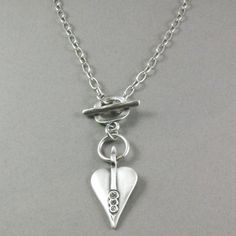 Danon Silver Plated Links necklace with Swaarovski Crystal Heart Now £45 from lizzielane.com http://www.lizzielane.com/product/danon-swarovski-crystal-silver-signature-heart-necklace/