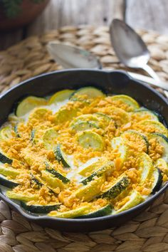Zucchini and Yellow Squash Skillet Gratin - tender crisp zucchini and yellow squash with a creamy white sauce.