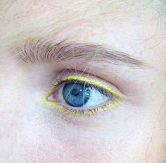 editorial makeup, fashion show, backstage, fashion week, yellow eyeliner