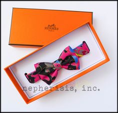 Hermes noeud silk papillon bow tie. New condition with Hermes box and ribbon.