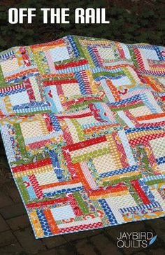 "Stashbusters often comment that new patterns are traditional blocks with a bit of spin. ""Off the Rail' (Jaybird Quilts) joins rail fence strip sets to center squares, probably with a partial seam technique. Fussy cut those center squares or put in a bit of embroidery to make it your own.                                                                                                                                                                                 More"