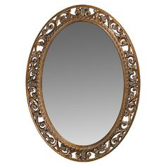 Wall mirror with a scrollwork frame and antiqued bronze finish. 37x27    Product: Wall mirrorConstruction Material: Resin...