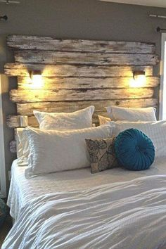 Wooden panels with lights as a headboard.. Pretty simple, love the idea.