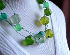 One of my most popular designs. I finally found a creative way to recycle telephone wire! Rounded cubes and round matte resin beads in six spring-y shades of green.  By J Sadler Designs.
