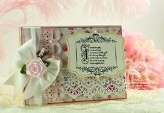 7-7-12.  RECIPE:  Stamps: JustRite Papercrafts -Vintage Filigree Fancies  Paper: My Minds Eye, Neenah Classic Crest – Natural White – 80 lb  Ink: Versafine Onyx Black  Accessories:Spellbinders™ Jar Labels,Spellbinders™ Classic Scallops,Spellbinders™ Classic Decorative Inserts Five, Silk Ribbon, Ribbon Flower, lace, pearls, pearl pic, Recollections Pearls
