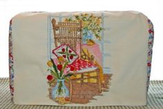 a sewing machine cozy using vintage linens