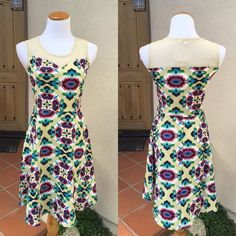 Bright Aztec Fit Flare Summer Dress Amazing tan dress with bright Aztec print! Sheer mesh top panel. Fit and flare style. So cute! Dresses are marked M & L, however they run a full size small. They really fit like S and M. So if you're normally a small, I'll send you a medium. And normally a medium I'll send you the one marked large, etc. My mannequin is a medium wearing a large.    65% Cotton, 30% Polyester, 5% Elastane Boutique Dresses