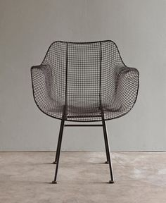 BISCAYNE ARMCHAIR - BROWN  $325.00  A classic chair in a garden patio or around a mid-century dining table.