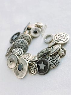 Button bracelet. Start with a link bracelet, 40 to 60 buttons with shanks (those small loops protruding from the backs), an equal quantity of jump rings, and a pair of needle-nose pliers. Click for instructions.