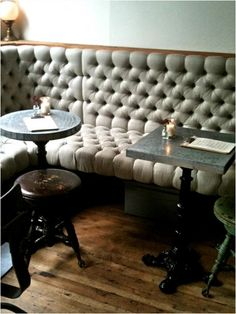 LOVE this tufted banquette with tiny tables