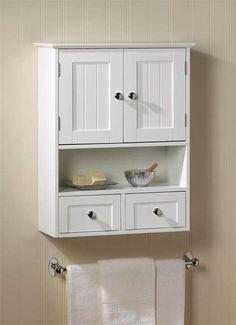 Charm and practicality come together in perfect harmony with this wall cabinet. It adds storage to any space with its two Nantucket-style doors and two pullout drawers, along with its open display shelf. Its perfect for the bathroom and beyond! Wall Mounted Display Cabinets, Wall Storage Cabinets, Wall Mounted Bathroom Cabinets, Bathroom Medicine Cabinet, Cabinet Drawers, Cabinet Knobs, Glass Shelves, Bathroom Wall Storage, Bathroom Ideas