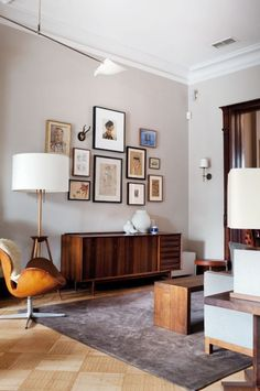 Love this simple, classy gallery wall. Great piece below it to ground it.