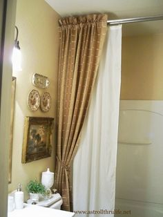 A Stroll Thru Life: Answers to How I Did the Shower Curtain.  Awesome idea.  Hang two shower rods.