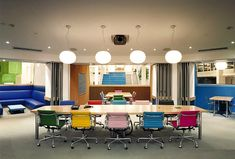 LOVE the multi-color chairs in this conference room