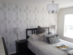 Serene Bedroom Makeover with Serenity faux wood stamped wallpaper.