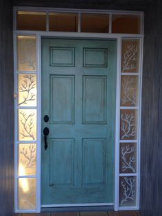 Coastal Front Door~my first pin!! Door painted in sea glass, weathered w/burnt sienna. Side windows painted on inside w/glass paint, ouside of side windows painted w/Martha Stewart Frosted Glass for added privacy. Walls faux painted to look like driftwood.