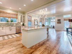 I thought I was all about dark hardwood floors, but this has me rethinking. LOVE the wood floor, and the wide boards.