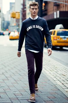 9175ed5779f Dark blue long-sleeve sweatshirt with faux leather appliqué. Create a rich  palette by