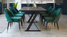 The Nala Dark Oak and Fern Green Clover Velvet Chair Set is a contemporary dining set with vintage inspired dining chairs and urban-style dining table, creating a modern luxe set suitable for families and entertaining Dark Wood Dining Table, 6 Seater Dining Table, Dark Table, Dining Table Chairs, Dining Area, Contemporary Dining Sets, Blue Velvet Chairs, Green Dining Room, Fern