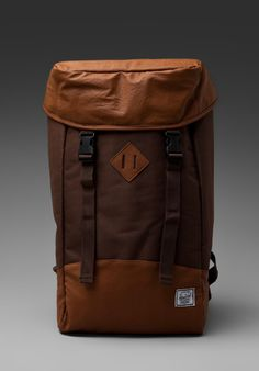 """Herschel supplies backpacks & bags that are modern in shape with loads of crafted detail. Inspired by the old-school American mountaineering heritage and world travel, their collection is a new twist on all your vintage favorites. Canvas exterior with nylon lining Measures approx 14""""W x 22""""H x 4.5""""D Flap push release closure Adjustable shoulder strap Drawstring top Interior fleece lined slot for laptop Manufacturer Style No. Zippo"""