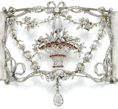 "Detail: Belle Epoque diamond and ruby plaque-de-cou, circa 1905.  A plaque-de-cou is a collier de chien (""dog"" collar featuring a large rectangular or square plaque suspended on a ribbon or strands of pearls."