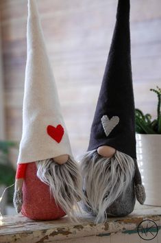 Nordic Gnome in new design with hands This listing is for one Large Gnome Each gnome has linen blend fabric body. Wool Blend felt hat with a heart embroidery in red . Hands are made from grey knit material and mittens are knit knitted by me or felt mittens. Choose from the drop down
