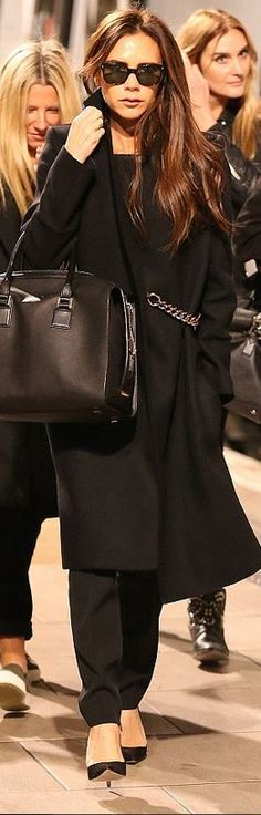 Victoria Beckham: Coat, sunglasses, and purse – Victoria Beckham Collection  Shoes – Manolo Blahnik