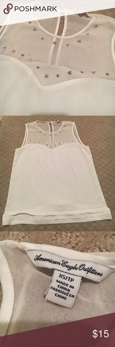American Eagle Tank Cute AE tank with sheer top and embellishment along neckline and stitching where the sheer top meets the bottom! Key hole in the back. Easy to dress up or dress down 🤗 would fit XS or S American Eagle Outfitters Tops Tank Tops