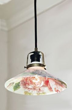 We love this decoupage lamp, which adds a charming touch to the room.