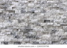 Alabaster masonry cladding tiles wall texture. White stone surface interior background.
