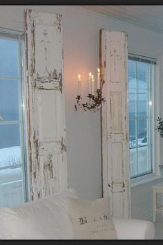 Loving all white bedrooms right now-love these weathered shutters