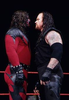 """Strange videos featuring Kane's former mask set on fire have announced the Big Red Machine's """"resurrection."""" Take a look through the years Kane spent terrorizing WWE while wearing the horrific mask. Wrestling Stars, Wrestling Wwe, Kane Wwf, The Undertaker, Wrestlemania 29, Vince Mcmahon, Wrestling Superstars, Thing 1, The Brethren"""