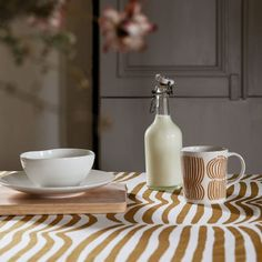 The graphic Vilja pattern designed by Minna Niskakangas is inspired by golden fields of grain swaying in the early autumn breeze. The modern design language of the collection works beautifully in city homes, country cottages and everything in between. Vilja products fit wonderfully in modern Scandinavian interior style. Vilja ceramic mug made in Finland and the tablecloth made of Vilja fabric make kitchen look cozy. The collection consists of two colors: earthy brown and fresh pink. Modern Scandinavian Interior, Early Autumn, Country Cottages, Design Language, Finland, Interior Styling, Earthy, Breeze, Fields