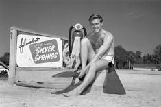 """A scuba diver putting on his flippers next to a sign that says """"Filmed at Florida's Silver Springs"""" Photo by Bruce Mozert. Florida Springs, Snl, Put On, Caption, 1960s, Tours, America, Memories, Silver"""