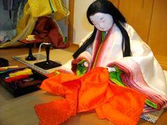 a heian lady preparing new robes: I adore her kasane colours, ume/plum!