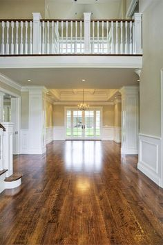 Wow - I just like all that open space, wood floors, crossover landing across the top....what's not to love?