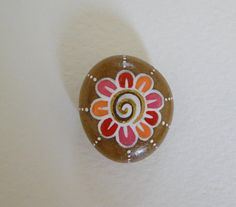 Painted Pebble - Flower via Etsy