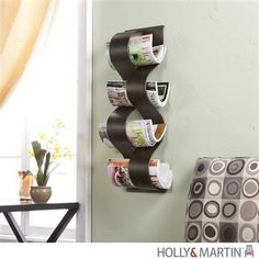Organize in style! Add a modern touch to your space with this unique Magazine Wall Rack.
